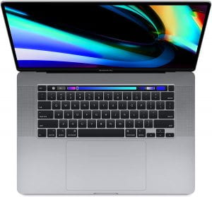 A MacBook Pro viewed from the top down. A touch bar is visible at the top of the keyboard close to the screen.