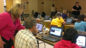 Ed Tech Kim Roush helps a participant during the video creation workshop in Belle Valley.