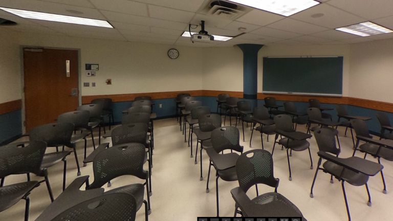 Picture of traditional classroom with desks and blackboard (Enarson Classroom Building room 209)