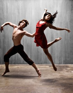 Two dancers moving fluidly to music.
