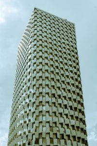 A tall round hotel tower