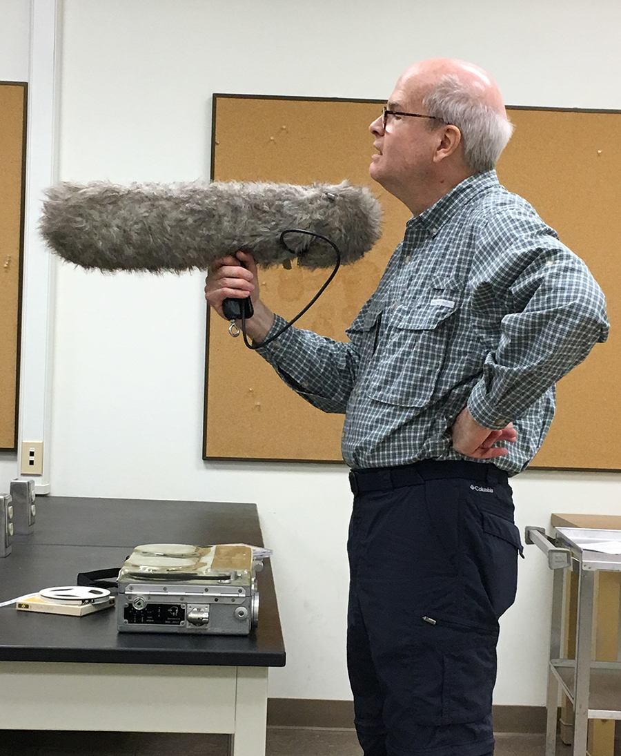 Doug Nelson shows microphone used to record bird songs