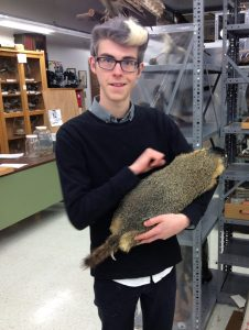 Grant Terrell proudly presenting a specimen of yellow-bellied marmot