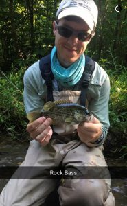Scott Glassmeyer holding a Rock Bass (fish)