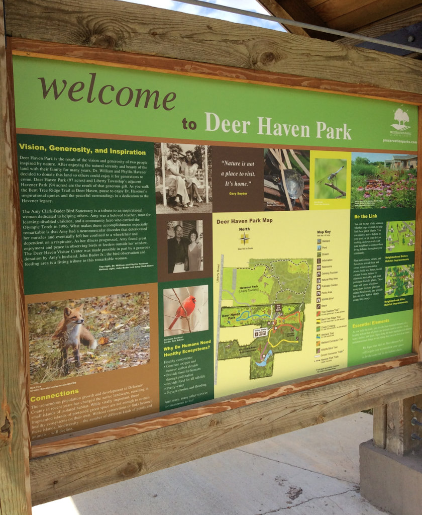 sign welcoming visitors to Deer Haven Park