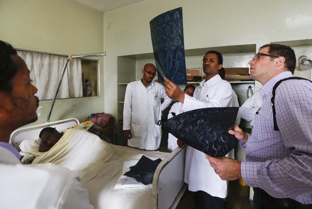 Eric Sauvageau, right, looks at a scan at Addis Ababa University hospital.