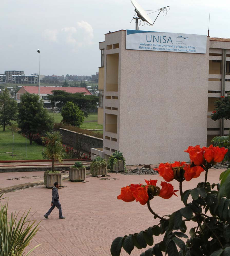 A student walks through Addis Ababa University Akaki campus on July 8, 2013.
