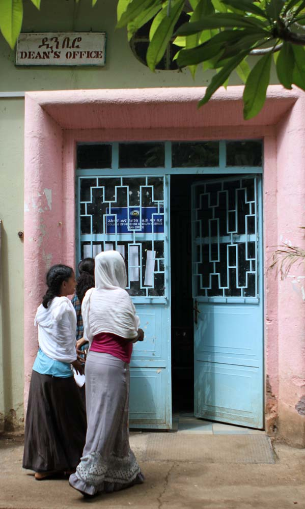 Women walk into the Dean's Office at the University of Gondar Hospital.