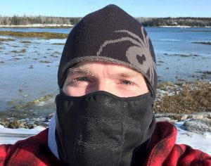 Dr. Roberts wearing a face mask and hat to protect him from severe cold