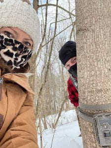Dr. Weyrauch (foreground) and Dr. Roberts (background) placing camera traps in February, 2021