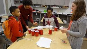 TEK8 and KIPP students working on a designing a current bridge.