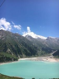 Bright blue lake between mountain peaks