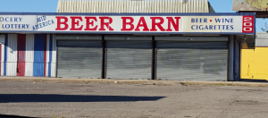 The Beer Barn on 5th Ave is an example of wasted space that could be replaced with healthy option groceries.