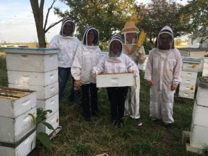 club members with beekeeping equipment