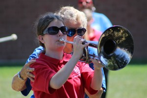 Marching Assistant helping a student