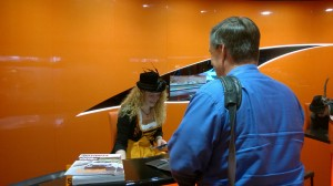 Max getting help from a Fraulein at the Rental Car agency.