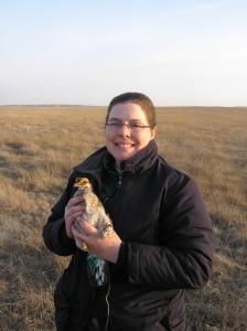 Jackie Augustine holding a prairie-chicken in Kansas