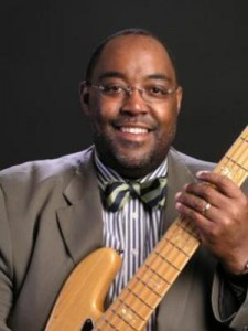 Picture of Dr. Ruffin holding electric bass