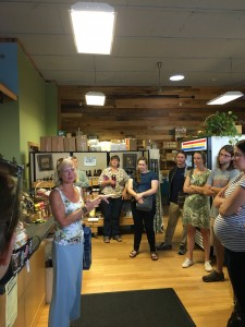 Kimmy Clements, manager of the Highland Market gives meeting participants a tour of the market in Davis, West Virginia.