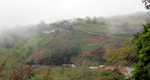 View from the mountains.  Note the terraced agriculture and full sugar cane truck in the road below us.