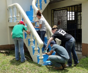 Painting the stairs of the church.