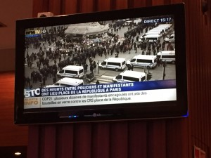 The hotel TV showed events just outside the doors.