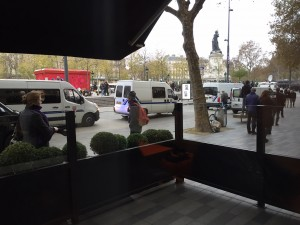 View from the hotel: Police vans move in