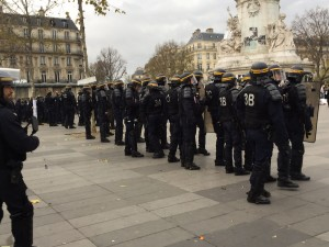 Row of police move closer