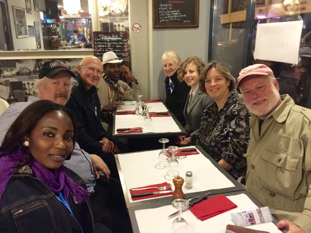 A group from the Sierra Club catches dinner at a pizzeria in Paris. Clockwise from the lower left are Mavis Mensah, Youth Volunteers for the Environment, Togo; Fred Heutte, Federal and International Climate Campaign; Glen Besa, Virginia Chapter; Sena Alouka, Youth Volunteers for the Environment, Togo; Tyla Matteson, Virginia Chapter; Nicole Ghio, International Campaign; Cathy Becker, Ohio Chapter; and Steven Sondheim,Tennessee chapter.  Photo by Katherine Muller.
