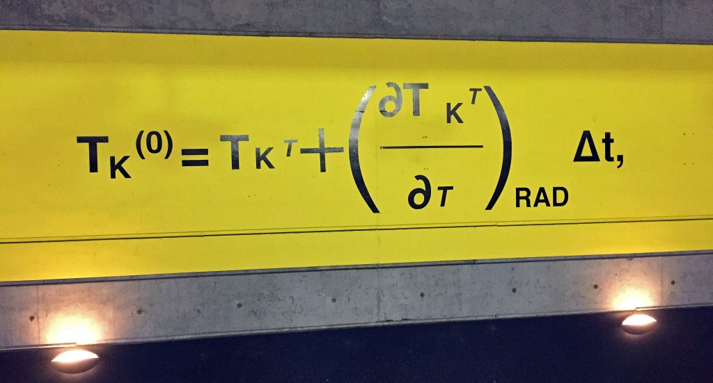 A series of equations related to the general circulation model of climate lines the train stop to Le Bourget at Gare du Nord in Paris.