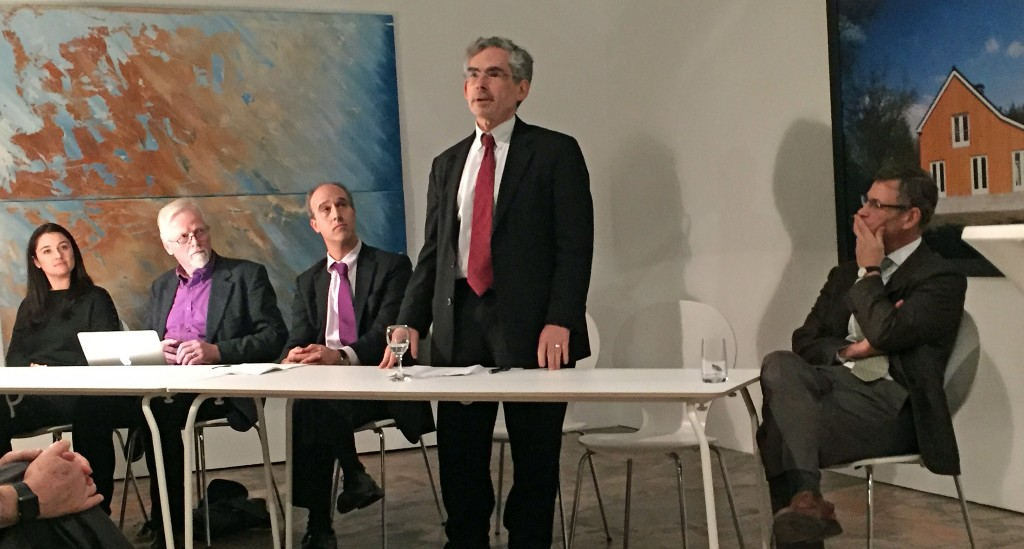 Michael Gerrard (standing) and other panelists at the Exxon Knew event.