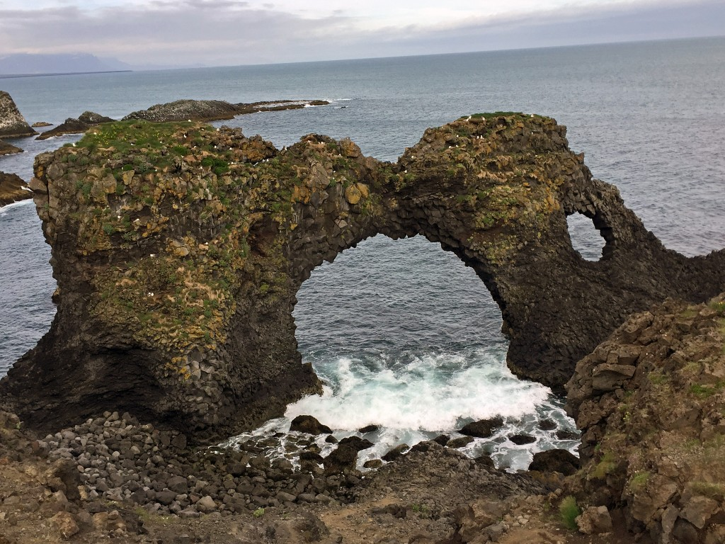 Gatklettur, the natural arch rock on the 2.5 km hike from Arnarstapi to Hellnar.