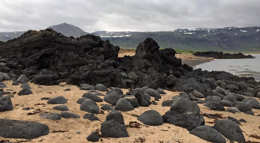 Big black lava rocks on the beach at Budir.