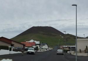 Helgafell, an inactive volcano, overlooks the street leading to Eldheimar Volcano Museum