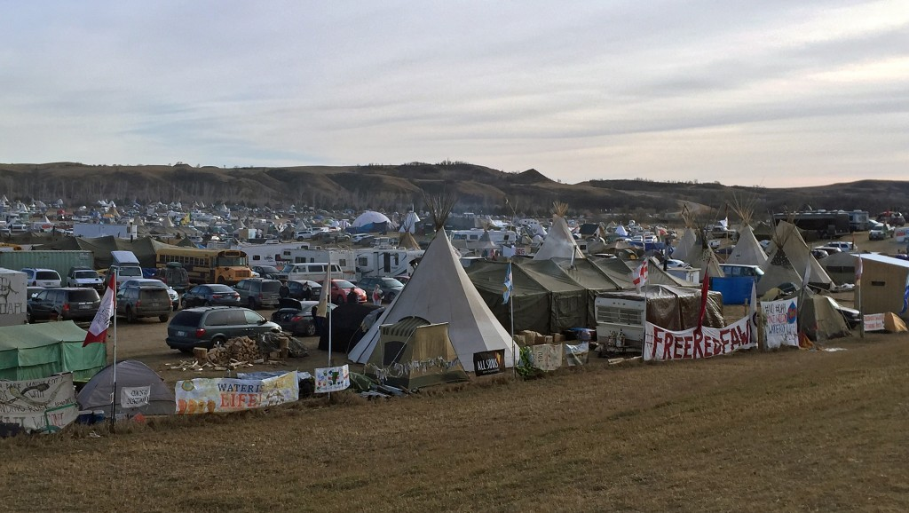 Oceti Sakowin camp from Hwy. 1806. Red Fawn is a water protector arrested on October 27 and still being held by police.