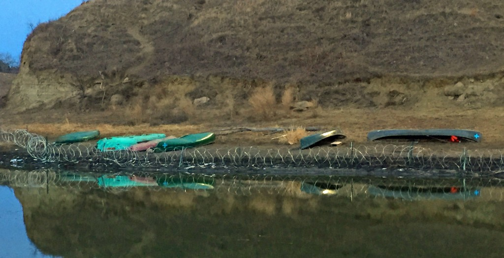 Busted up kayaks and canoes at the bottom of Turtle Mountain
