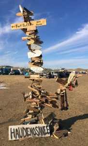 A display at Oceti Sakowin camp points to way to may places
