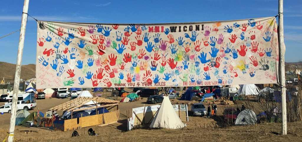 A banner at Oceti Sakowin camp says Mni Wiconi or Water is Life