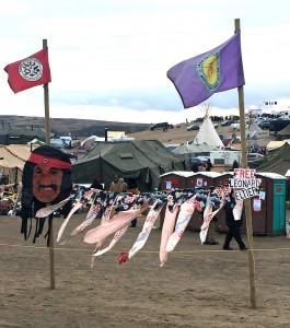 Ribbons tied between flagpoles at Oceti Sakowin camp
