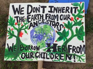 A sign left near the Washington Monument after the People's Climate March.
