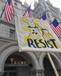 Resist banner near Trump International Hotel in Washington, DC.