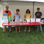 Four scientists at an outdoor booth about zebrafish