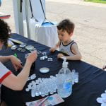 Boy doing bug activity at Museum of Biological Diversity booth