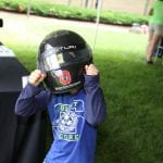 Young child wearing a motorcycle helmet