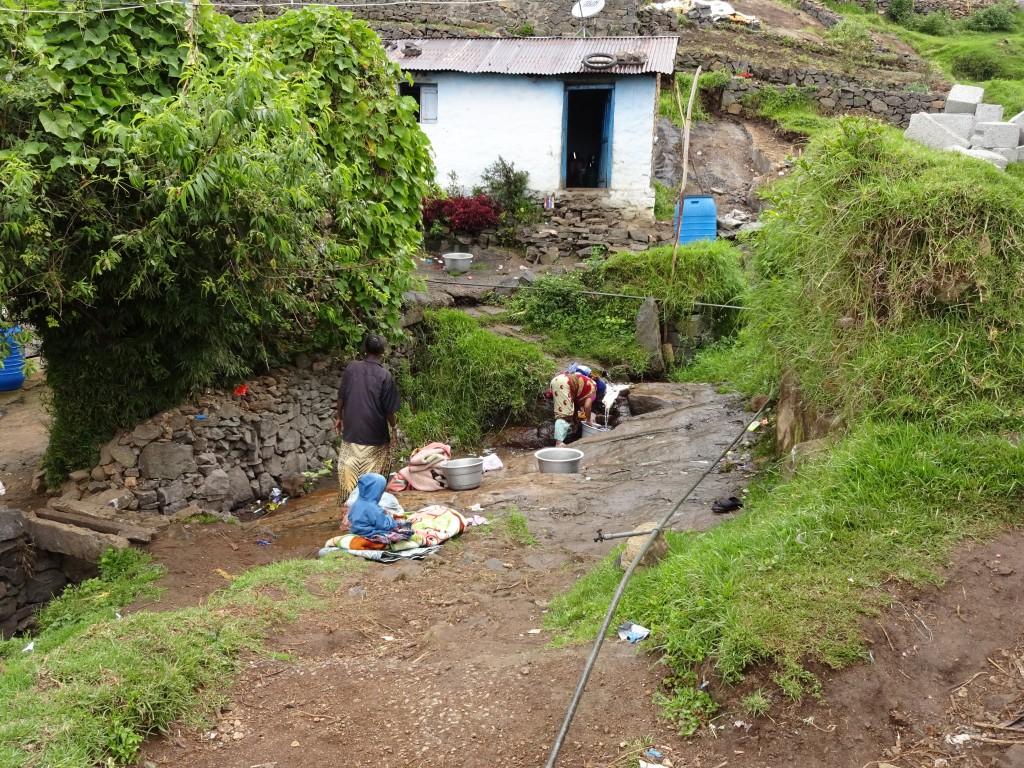 Women doing laundry in the stream