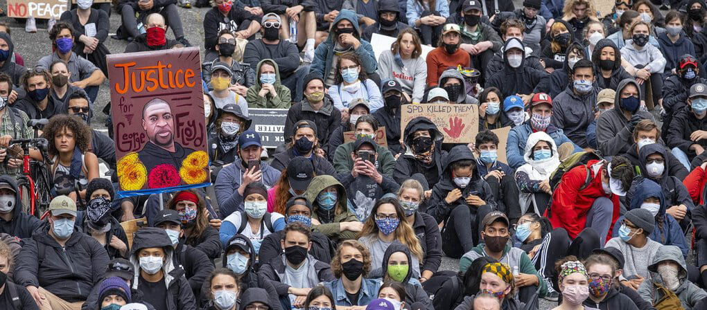 Thousands of protesters gather at Fifth Avenue and Washington Street in downtown Seattle, Tuesday. Despite repeated warnings about the danger of crowds spreading coronavirus, public health officials say they largely support the protests springing from the... (Dean Rutz / The Seattle Times)