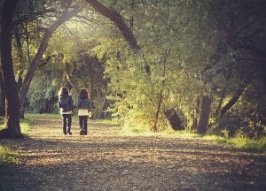two children on forest path