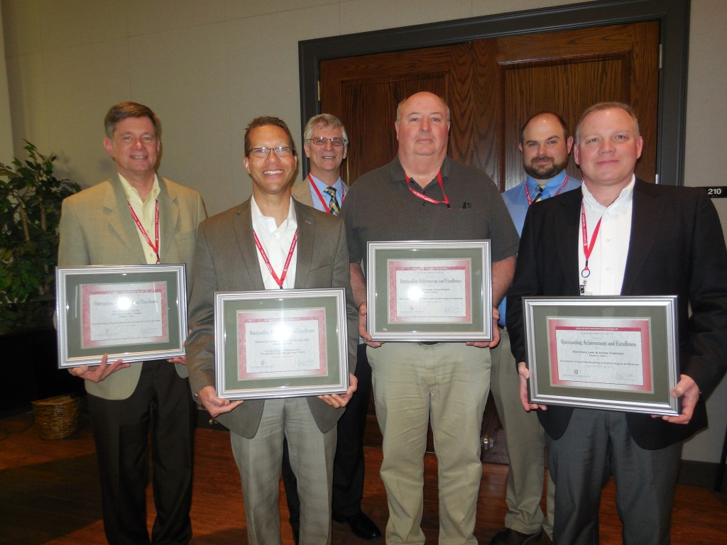 from far left: Rev. Kenneth Daniel (United Church Homes), from center: Scot McLemore (Honda of America Manufacturing, Inc.), Dave Rasor (Triumph Thermal Systems, Inc.), Mike Patrick (National Lime & Stone Company), in the back (left): Mike Giangiordano (Triumph Thermal Systems) and (right) Dan Sensel (Triumph Thermal Systems)