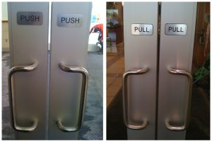 Push and pull doors, both with handles