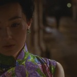 Su sadly ponders the end of her relationship wiht Zhou in Wong Kar-wai's In the Mood for Love